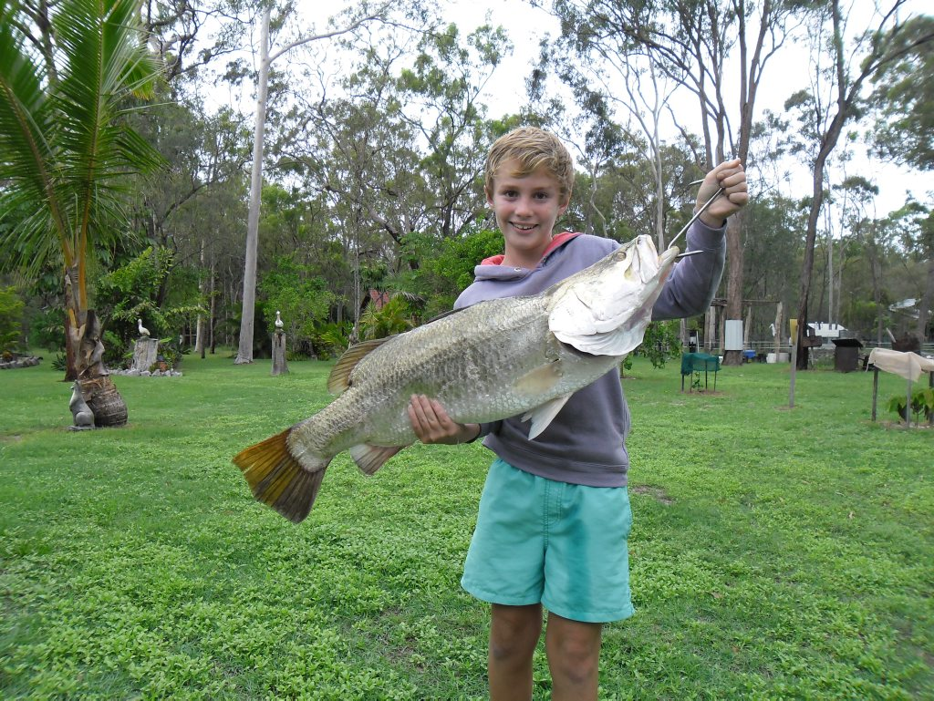 Lachlan Joynson with his 9.4kg Barra caught in the Boyne Last weekend. Photo Contributed