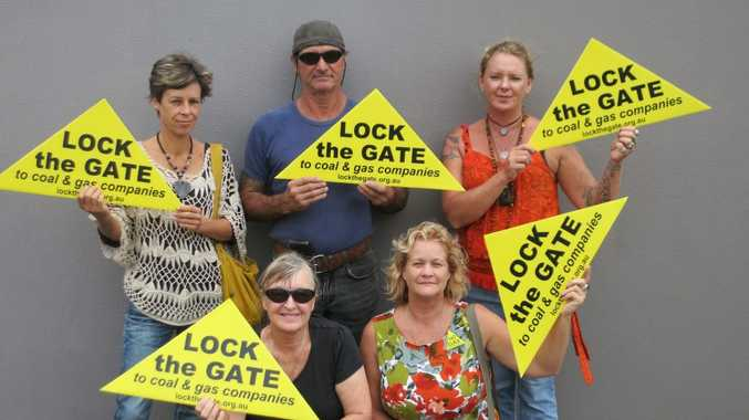 NO COAL: Susan Benedik, Noel Bartley, Vicky Perrin, Penny Taylor and Sue Berry of Lock the Gate Alliance take action in Bundaberg. Photo: Leah Kidd / NewsMail