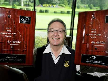 Toowoomba City Golf Club general manager Peter Constance with the two club of the year awards.