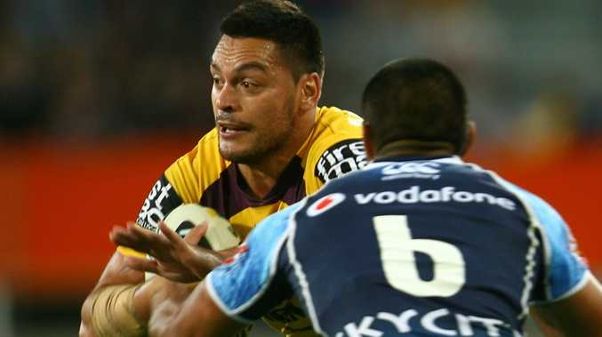 Alex Glenn of the Brisbane Broncos is tackled during the NRL Trial match between the New Zealand Warriors and the Brisbane Broncos at Forsyth Barr Stadium on February 23, 2013 in Dunedin, New Zealand.
