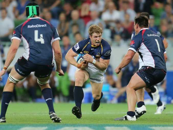 David Pocock of the Brumbies runs with the ball during the round two Super Rugby match between the Rebels and the Brumbies at AAMI Park on February 22, 2013 in Melbourne, Australia.