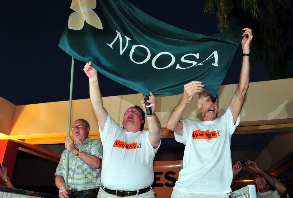 Noel Playford , Member for Noosa Glen Elmes and Friends of Noosa President Bob Ansett celebrate the de-amalgamation victory with hundreds of supporters outside Council Chambers earlier this year.