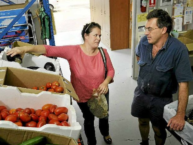 ORGANIC SHIFT: Mr Organic owner Murray Griffiths chats with customer Jane Naug about the changing attitude towards organic food.