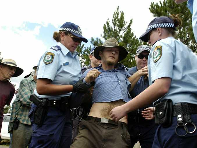 A protester from Brisbane is arrested during last year's Doubtful Creek CSG blockade.