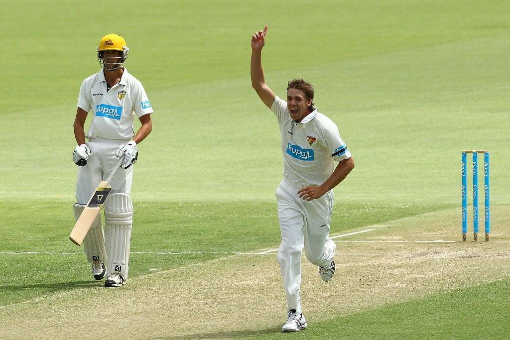 Luke Butterworth of the Tigers celebrates dismissing Sam Whiteman of the Warriors during day two of the Sheffield Shield match between the Western Australia Warriors and the Tasmania Tigers at WACA on February 22, 2013 in Perth, Australia.