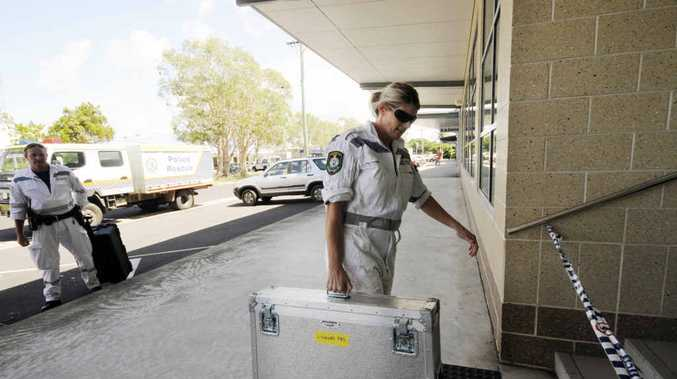 MAIL SCARE: Police enter the Ballina Community Services office after a suspicious package was found.