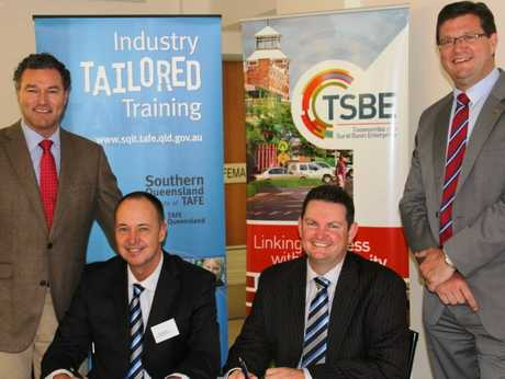 At the signing of a Memorandum of Understanding are Minister for Education, Training and Employment John-Paul Langbroek, SQIT director Trevor Swenke, Toowoomba and Surat Basin Enterprise CEO Shane Charles and Member for Toowoomba North Trevor Watts.
