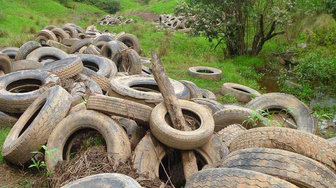 Tyres stacked after an early attempt to clear them from a watercourse.