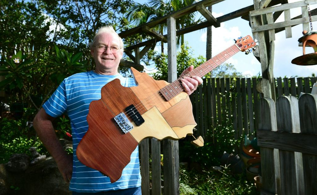 Woodworker and Guitar maker Ray Mole of Collingwood Park with his map of Australia guitar.