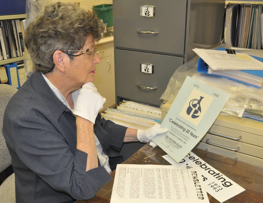 Gladstone Regional Art Gallery & Museum Art research officer Marilyn Haertel looks over some of the history documents of the Gladstone Area Potters Group.