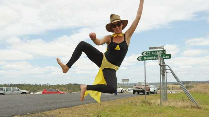GAS GONE: One of the Girls Against Gas celebrates the news that Metgasgo has suspended operations in the Northern Rivers. (Photo: David Lowe)