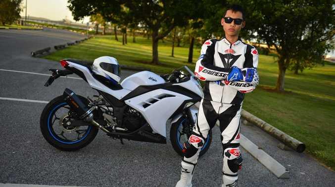 Matahari Sumadi shows off his Kawasaki Ninja 300R.