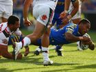 Chris Sandow of the Eels dives over to score a try during the round one NRL match between the Parramatta Eels and the Warriors at Parramatta Stadium on March 9, 2013 in Sydney, Australia.