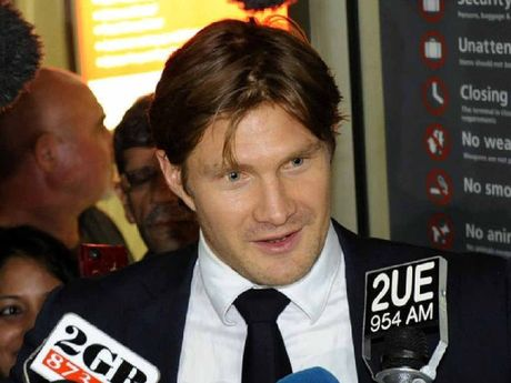 BACK HOME: Shane Watson arrives at Sydney Airport on Tuesday.