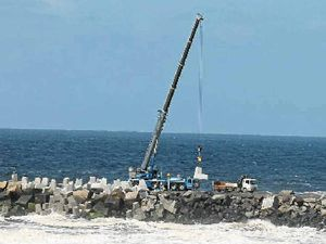 Crane builds breakwall jigsaw