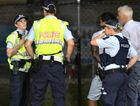 Police make an arrest following a disturbance at Virgin Australia Stadium during the NRL trial game on February 23.