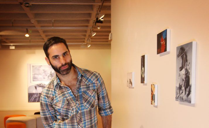 Michael Zavros with some of his work on display at the Rockhampton Art Gallery.