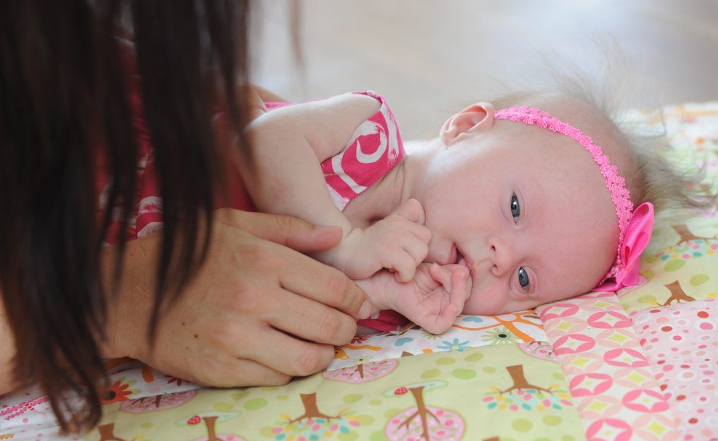 Joelle Kelly with her daughter Josee (9 weeks) who was born with Down syndrome.