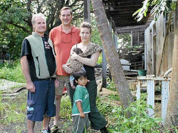 CONCERNS: Little Keen St residents, in front of the house planned for demolition, are (from left) John Trapp, Tony Gilding, Jade Bening with baby Loretta and Django Bening.