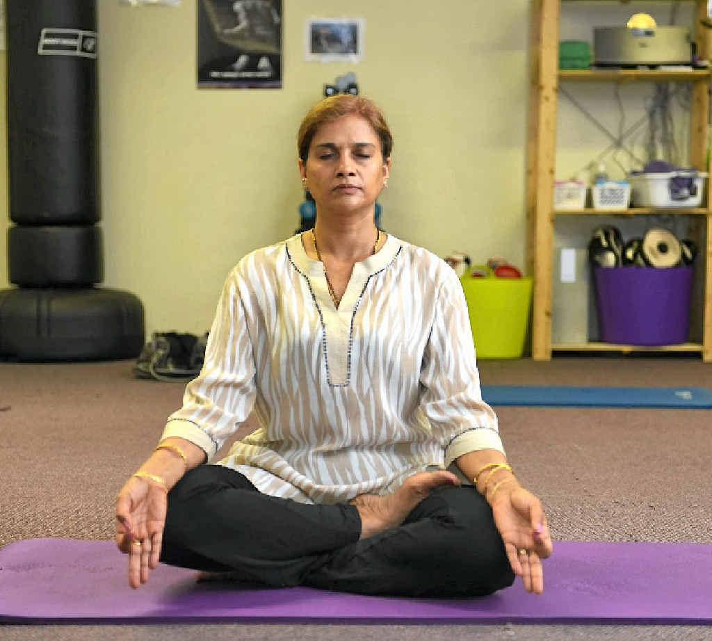 Yoga guru Pushpa Bakshi in the sukasan pose.