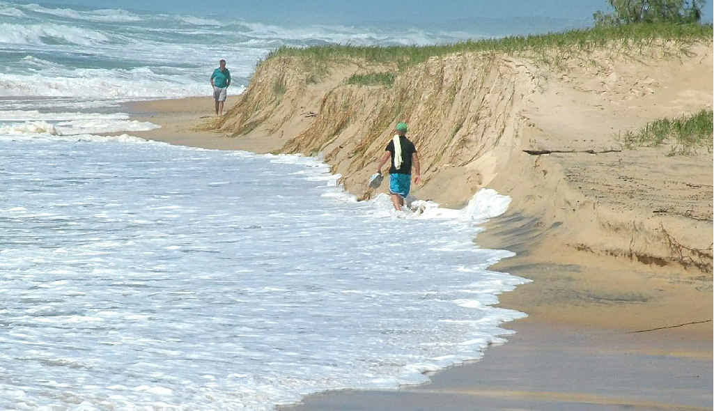 The heavy seas at Sunshine Beach have created dangerous sand cliffs.