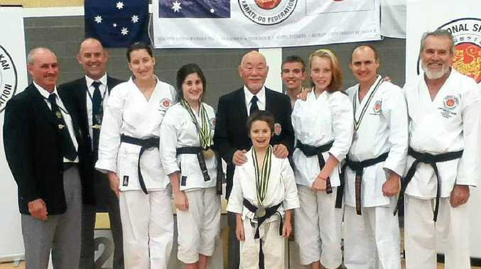 TOP EFFORT: Northern Rivers karate exponents with officials after their notable performances at the recent national titles in South Australia.