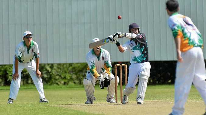 HITTING OUT: Farleigh Magpies batsman Kevin Napier hits out against Pioneer Valley, as keeper Troy Thompson waits for a chance in the 2013 season.