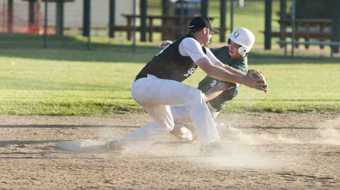Warriors player Myles Davis is out at second base by Dodgers' Brett Harrigan in Saturday's men's A-grade grand final.