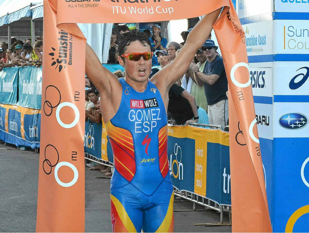 SIMPLY TOO SLICK: Spain's Javier Gomez crosses the finish line in triumph at Mooloolaba yesterday.