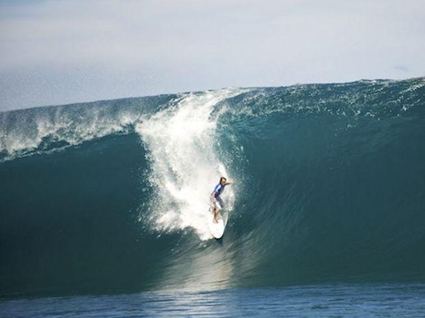 Mark Visser surfs Teahupoo
