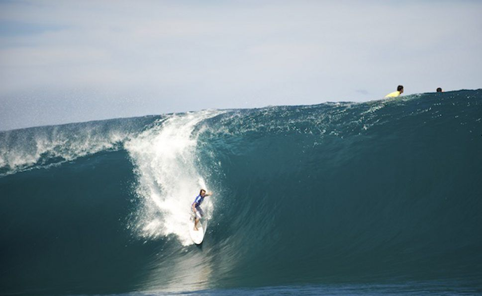 Mark Visser surfs Teahupoo