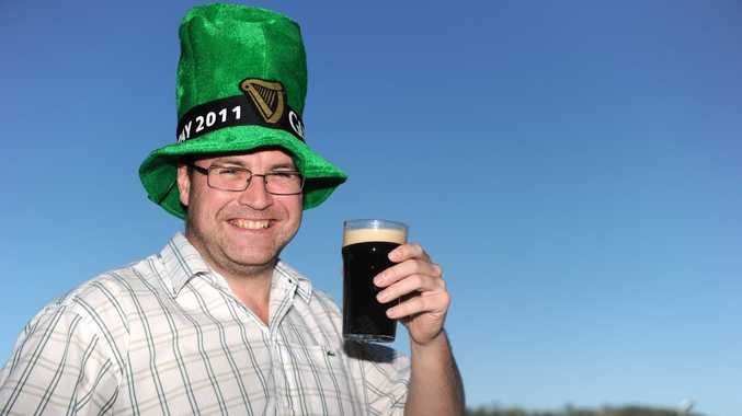 Mick Heatherington enjoys a Guiness in the sun while celebrating St Patrick's Day at Dicey's, Gladstone.