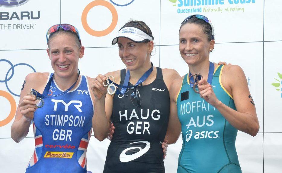 Mooloolaba Triathlon winner Anne Haug (centre), with Jodie Stimpson (left) who was second and Emma Moffatt in third.