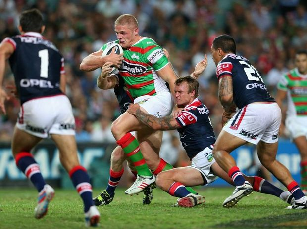 George Burgess of the Rabbitohs is tackled during a match between the Sydney Roosters and the South Sydney Rabbitohs.