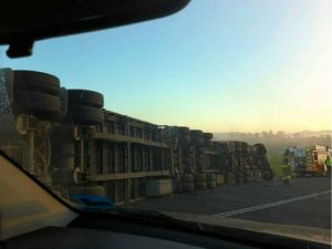 B-double rollover causes highway traffic delays