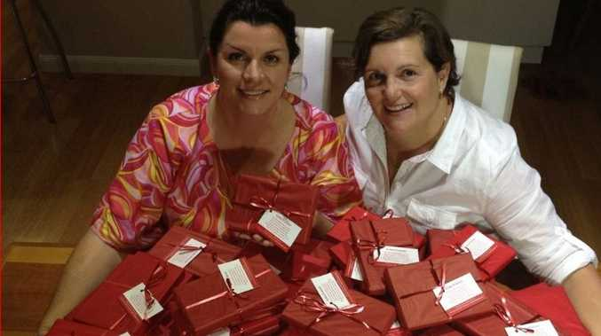 Anna Barlett and Jen Perrignon provide picture frames to hospitals for bereaved families.