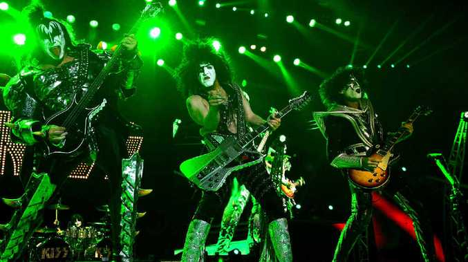 KISS, Gene Simmons, Paul Stanley, Tommy Thayer and Eric Singer on drums (behind) rock the stage in front of thousands of excited fans in Mackay.