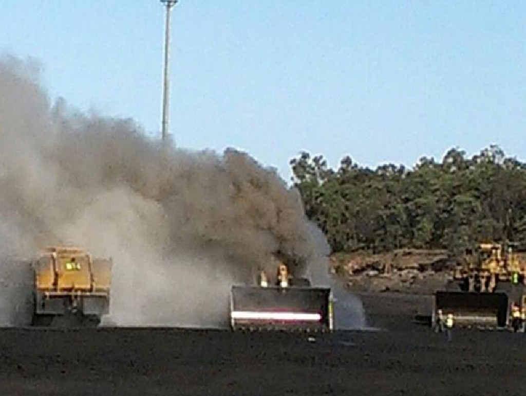 Smoke pours from heavy machinery at Saraji Mine.