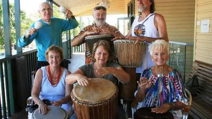 Happy drumming seniors: Judy Gibson, Gwen Gould, Feather, Param Berg, Veet and Graham Johnson were among those making a joyful noise at today's drumming circle for seniors
