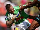 Josh Dugan of the Raiders is tackled during the round one NRL match between the Penrith Panthers and the Canberra Raiders at Centrebet Stadium on March 10, 2013 in Sydney, Australia.
