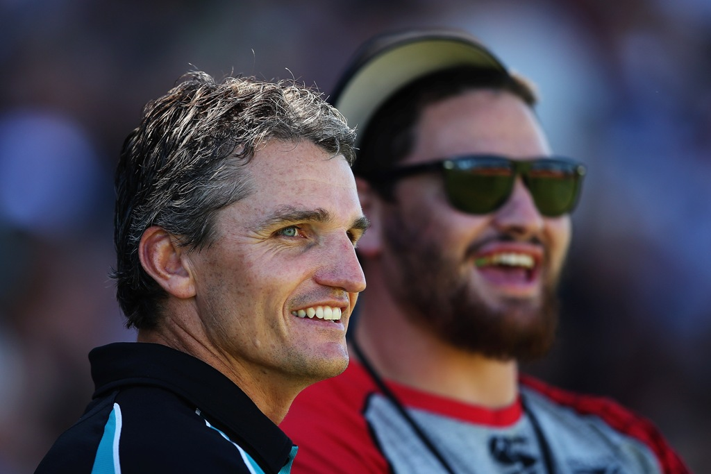 Head coach Ivan Cleary talks with Russel Packer of the Warriors ahead of the NRL trial match between the New Zealand Warriors and the Penrith Panthers at Waikato Stadium on February 16, 2013 in Hamilton, New Zealand.