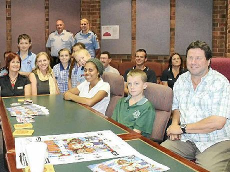 THE RIGHT TRACK: Students from Goonellabah Public School and Kadina High School help launch the Goonellabah Youth Protocol at LCC chambers with youth workers, council staff, police and councillors.