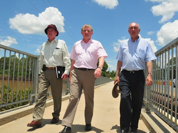 Former Minister for regional Australia Simon Crean, pictured with Nationals Party leader Warren Truss and former Fraser Coast mayor Mick Kruger, has been sacked from his ministerial position after a bizarre day in Australian politics.