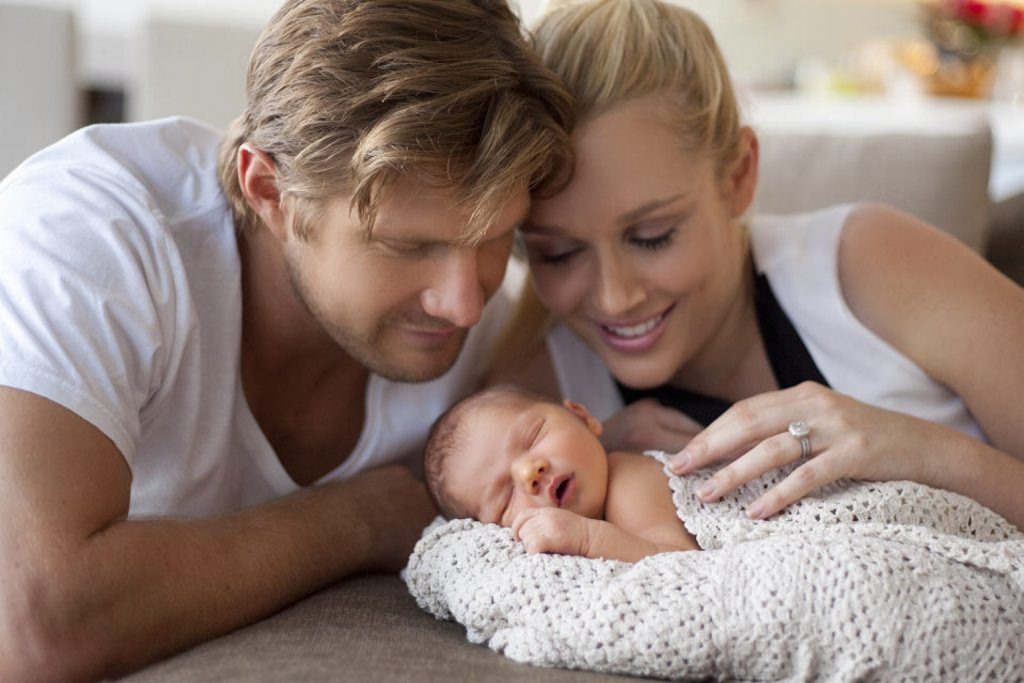 Cricketer Shane Watson with his wife, Lee Watson, and their new baby.