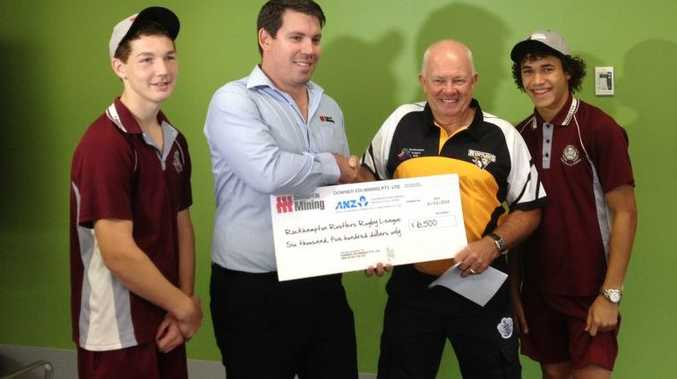 SEALING DEALS: Student Daniel Goodwin, General manager of operations Australia of DBS Duncan Etwel, Rockhampton Rustlers development manager John Harbin and student Justin Asse are looking forward to the inclusion of rugby league as a subject at North Rockhampton High. Photo Melanie Plane / The Morning Bulletin