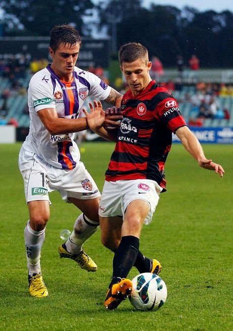 Shannon Cole of the Wanderers (R) competes with Joshua Risdon of the Glory during the round 22 A-League match between the Western Sydney Wanderers and the Perth Glory at Parramatta Stadium on February 23, 2013 in Sydney, Australia.