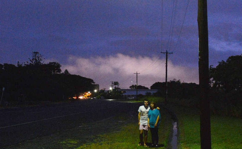 IN THE DARK: Natalie Spindler and her son Joshua Mitchell under one of the few street lights on East Gordon St.
