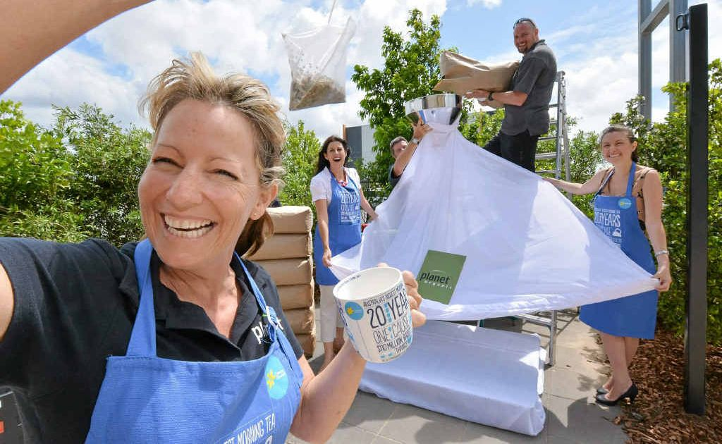 Carolyn Cook with Jodi Durkin, Brian Condon, Greg Walker and Shannan Walker get the measure of their giant teabag.