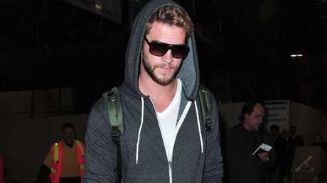 Liam Hemsworth arriving at LAX