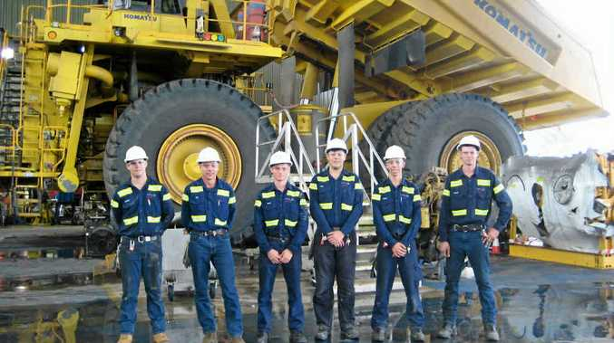 Hail Creek Mine maintenance manager Tim Branch (second from left) with apprentices (from left) Lachlan Duncan, David Suttle, Luke Young, Callan McLean and Brandon Shannon on site.